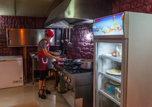 North Korean pizzeria cook in an italian restaurant, Pyongan Province, Pyongyang, North Korea