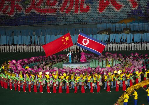 North Korean and chinese flags during the Arirang mass games in may day stadium, Pyongan Province, Pyongyang, North Korea
