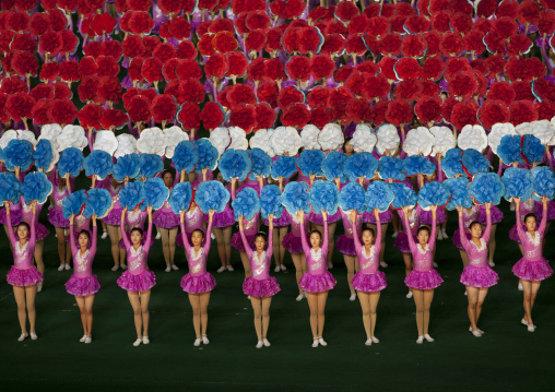 North Korean gymnasts holiding flowers during Arirang mass games in may day stadium, Pyongan Province, Pyongyang, North Korea