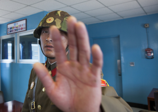 North Korean soldier refusing a picture in the conference room of the United Nations on the demarcation line in the Demilitarized Zone, North Hwanghae Province, Panmunjom, North Korea