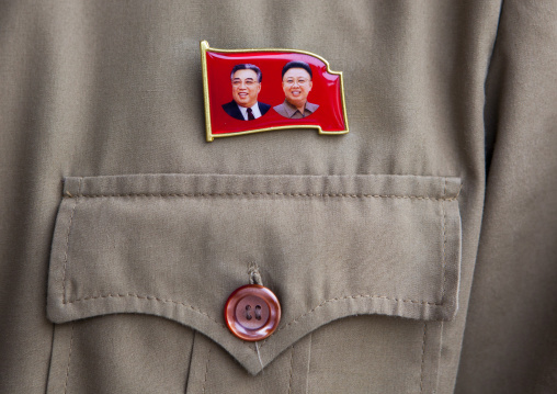 Dear Leaders badge on the shirt of a worker, North Hwanghae Province, Panmunjom, North Korea