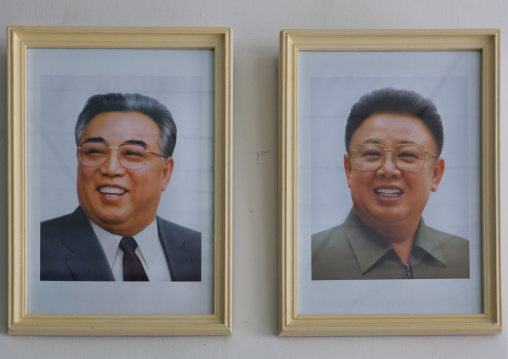 Kim il Sung and Kim Jong il official portraits in a house, North Hwanghae Province, Kaesong, North Korea