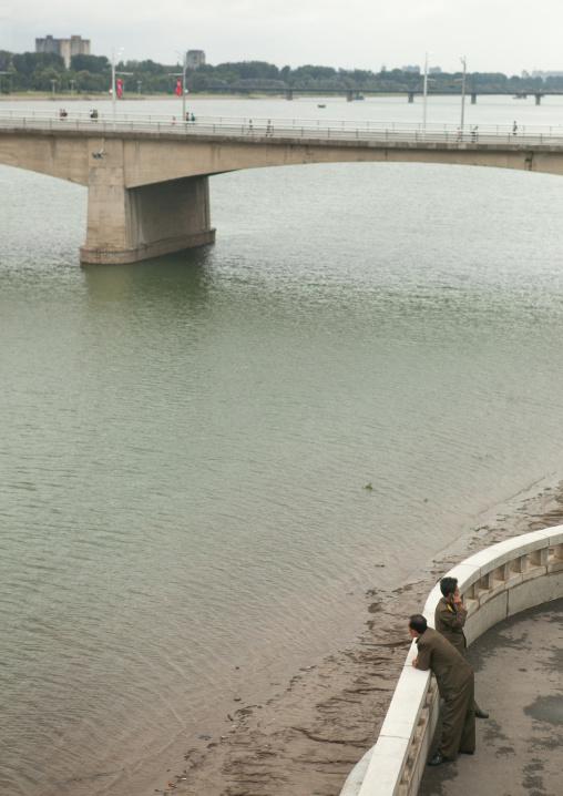North Korean soldiers looking over Taedong river, Pyongan Province, Pyongyang, North Korea