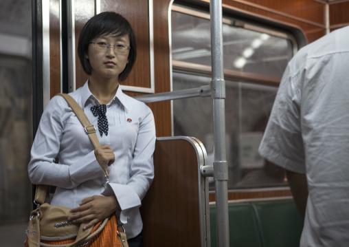 Young North Korean woman inside a subway train, Pyongan Province, Pyongyang, North Korea