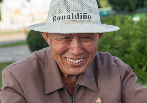 Portrait of a smiling North Korean man with a ronaldino hat, Pyongan Province, Pyongyang, North Korea