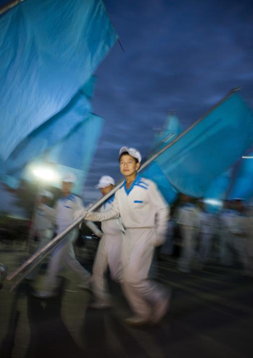 North Korean gymnasts with blue flags during the Arirang mass games in may day stadium, Pyongan Province, Pyongyang, North Korea