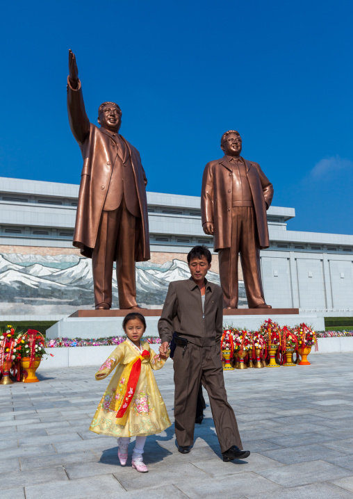 North Korean people in front of the statues of the Dear Leaders in Mansudae Grand monument, Pyongan Province, Pyongyang, North Korea