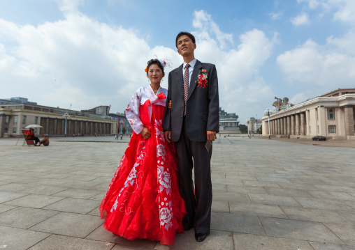 North Korean couple newly wed in Kim il Sung square, Pyongan Province, Pyongyang, North Korea
