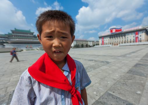 North Korean pioneer boy from the Korean children's union in Kim il Sung square, Pyongan Province, Pyongyang, North Korea