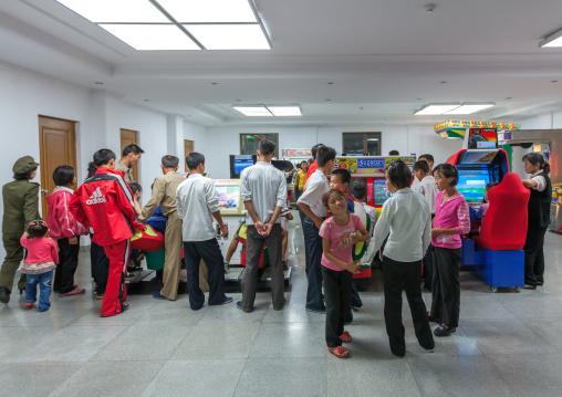 North Korean people playing video games in Kaeson youth park, Pyongan Province, Pyongyang, North Korea