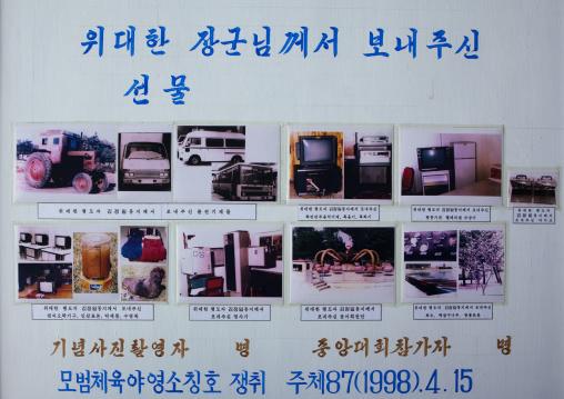 Propaganda billboard in Songdowon international children's camp depicting the gifts sent by Kim Jong-il, Kangwon Province, Wonsan, North Korea