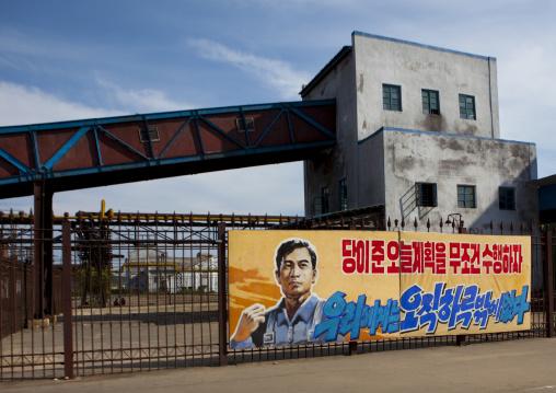 Propaganda billboard in Hungnam nitrogen fertilizer plant, South Hamgyong Province, Hamhung, North Korea
