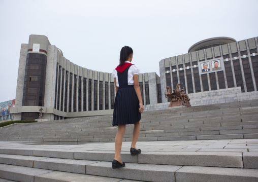 North Korean pioneer girl on the stairs of the Mangyongdae children's palace, Pyongan Province, Pyongyang, North Korea