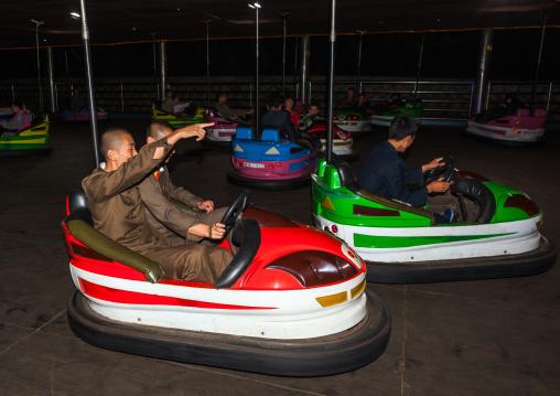 North Korean people having fun in bumper cars at Kaeson youth park, Pyongan Province, Pyongyang, North Korea