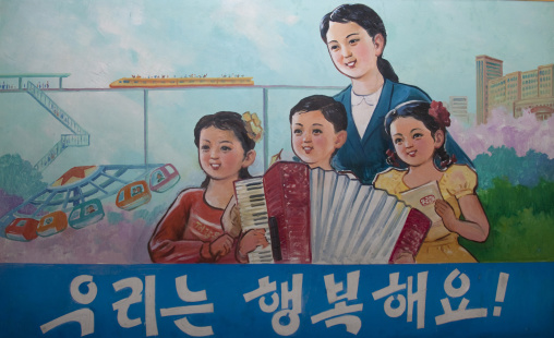 Propaganda poster in Tchang Gwang school depicting a North Korean family saying they are happy, North Hamgyong Province, Chongjin, North Korea
