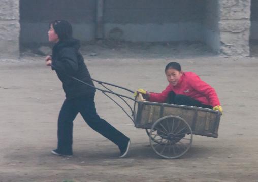 North Korean people pushing cart, North Hamgyong Province, Chongjin, North Korea