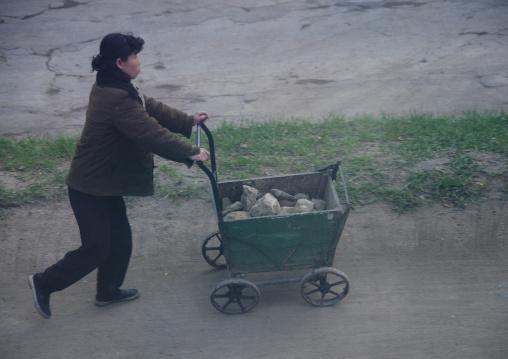 North Korean woman pushing a cart full of stones, North Hamgyong Province, Chongjin, North Korea