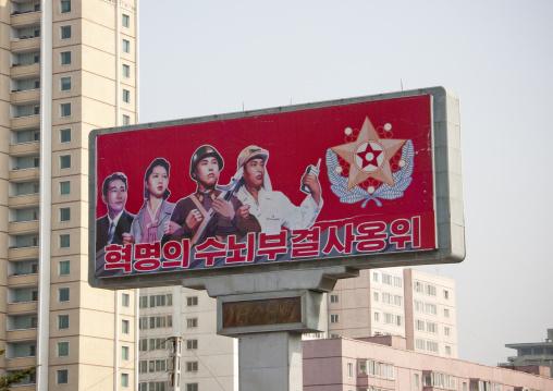 North Korean propaganda billboard with the flag of the supreme commander of the Korean people's army, Pyongan Province, Pyongyang, North Korea