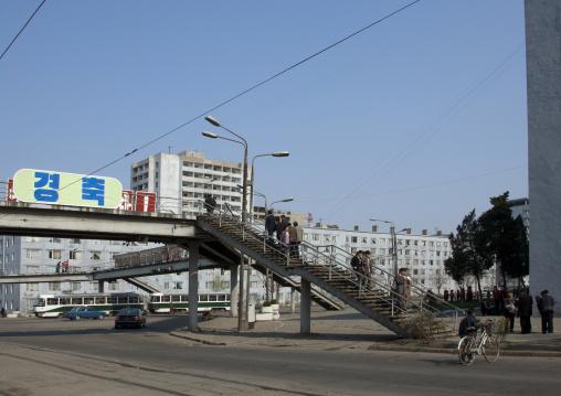 North Korean pedestrians using a footbridge in the city, Pyongan Province, Pyongyang, North Korea