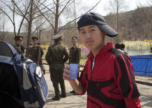 North Korean teenager with a cap at Taesongsan funfair, Pyongan Province, Pyongyang, North Korea