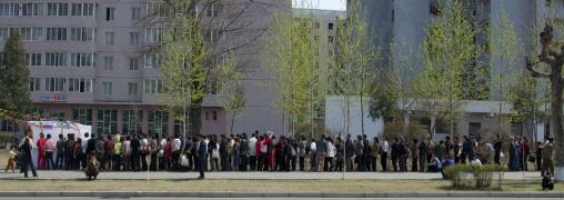 North Korean people queueing in the street to buy food, Pyongan Province, Pyongyang, North Korea