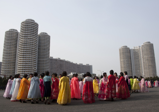 North Korean young adults during a mass dance performance in front of buildings on military foundation day, Pyongan Province, Pyongyang, North Korea