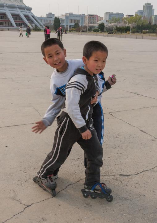 North Korean boys roller skating on a square, Pyongan Province, Pyongyang, North Korea