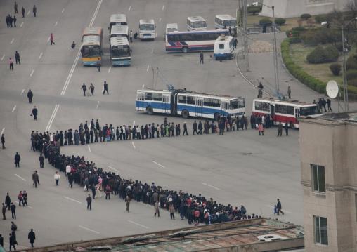 Crowd of North Korean people queueing in line for a bus, Pyongan Province, Pyongyang, North Korea