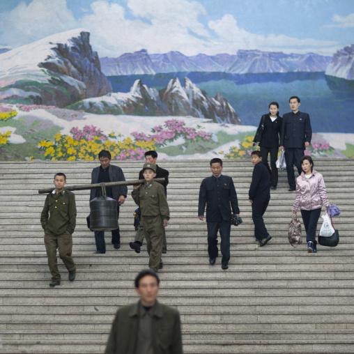 North Korean people entering Yonggwang metro station in frot of a mount Paektu fresco, Pyongan Province, Pyongyang, North Korea