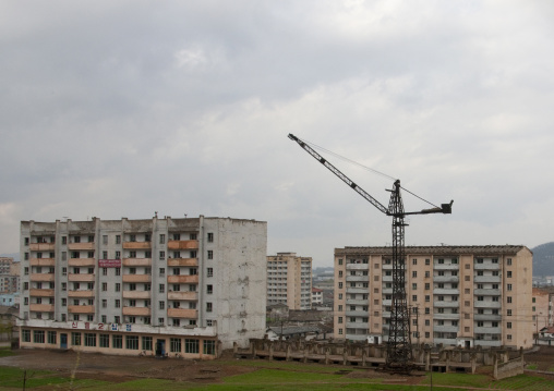 Crane in the middle of decrepit buildings, North Hwanghae Province, Kaesong, North Korea