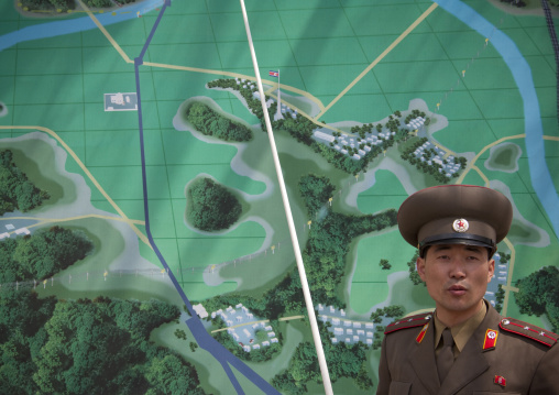 North Korean soldier in the joint security area in front of the map of the Demilitarized Zone, North Hwanghae Province, Panmunjom, North Korea