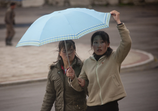 North Korean women under an umbrella, North Hwanghae Province, Kaesong, North Korea