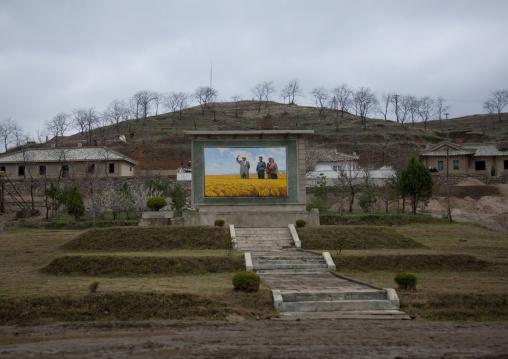 Propaganda fresco depicting the Dear Leaders in a field, North Hwanghae Province, Kaesong, North Korea