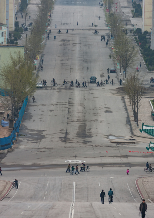 North Korean people crossing a large road, North Hwanghae Province, Kaesong, North Korea