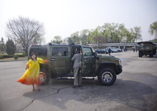 North Korean woman coming out of a hummer, Pyongan Province, Pyongyang, North Korea