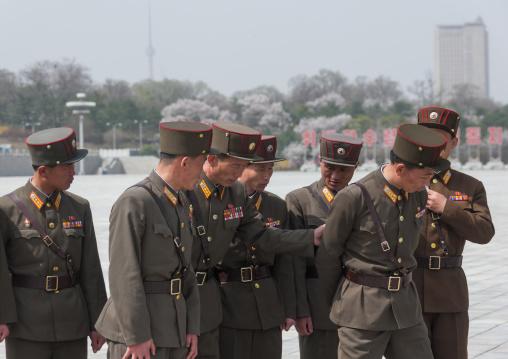 North Korean soldiers posing for a photo in Kumsusan memorial palace, Pyongan Province, Pyongyang, North Korea