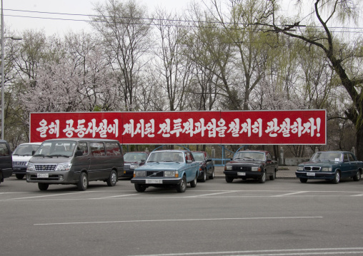 North Korean propaganda billboard on a parking, Pyongan Province, Pyongyang, North Korea