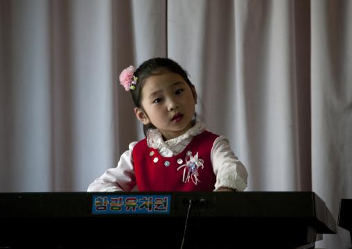 Young North Korean girl playing piano in Kwangbok school, Pyongan Province, Pyongyang, North Korea