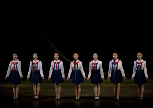 North horean pioneers girls singing during a show at Mangyongdae children's palace, Pyongan Province, Pyongyang, North Korea