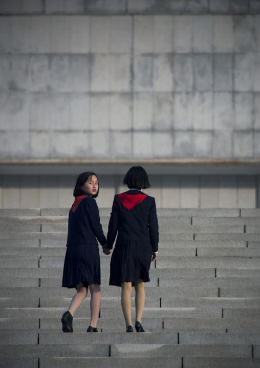 North Korean pioneer girls in the street, Pyongan Province, Pyongyang, North Korea