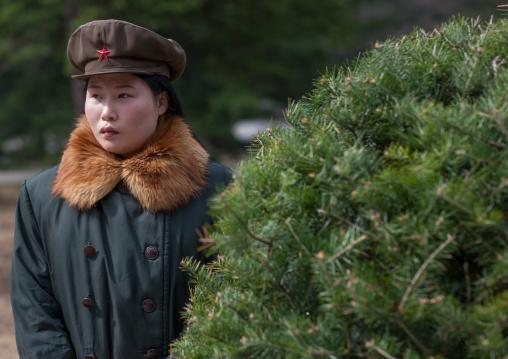 North Korean guide with a fur coat, Hyangsan county, Mount Myohyang, North Korea