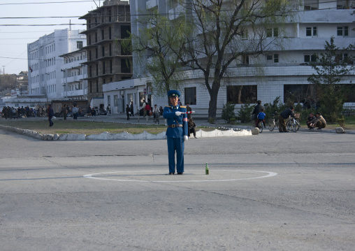 North Korean male traffic security officer in blue uniform in the street, Kangwon Province, Wonsan, North Korea