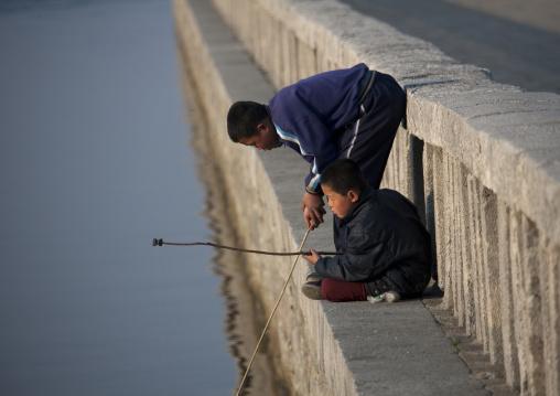 North Korean children fishing, Kangwon Province, Wonsan, North Korea