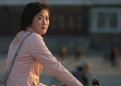Portrait of a North Korean woman on a bicycle, Kangwon Province, Wonsan, North Korea