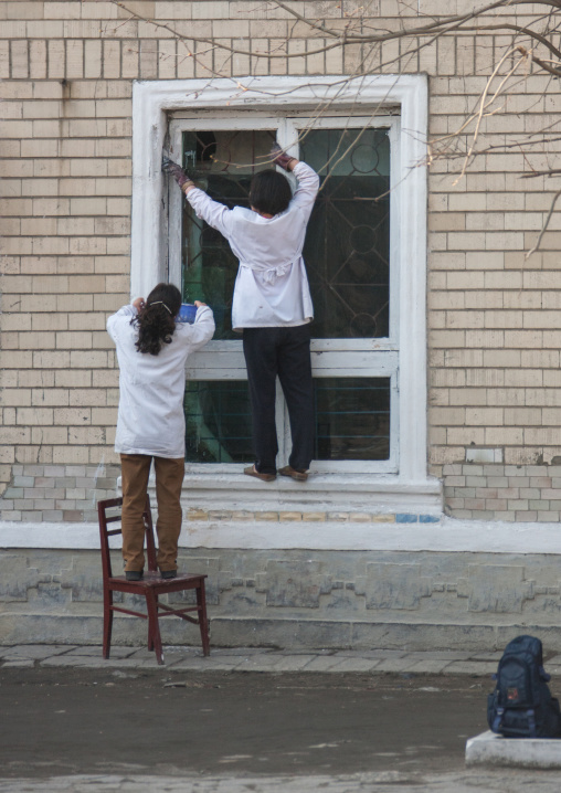 North Korean women fixing a window, Kangwon Province, Wonsan, North Korea