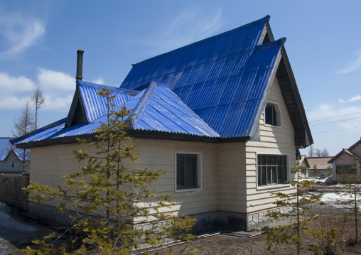 New apartment houses with blue roof in the countryside, Ryanggang Province, Samjiyon, North Korea