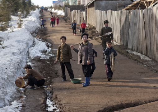 North Korean women using melted snow as washing water, Ryanggang Province, Samjiyon, North Korea