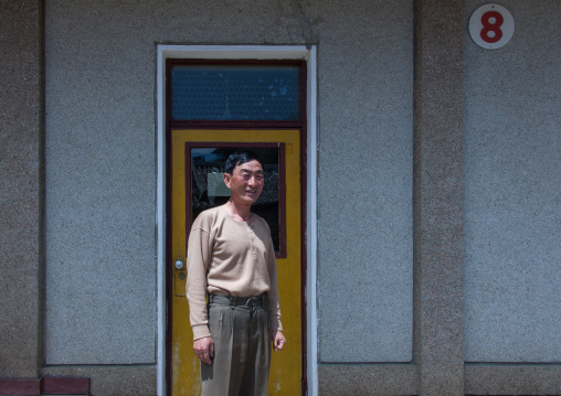 North Korean man in front of his house in a village, North Hamgyong Province, Jung Pyong Ri, North Korea