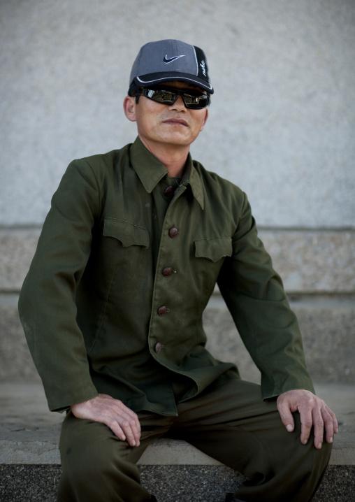 North Korean man wearing sunglasses and a Nike cap, North Hamgyong Province, Jung Pyong Ri, North Korea