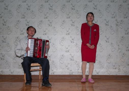 North Korean people singing inside a house, North Hamgyong Province, Jung Pyong Ri, North Korea